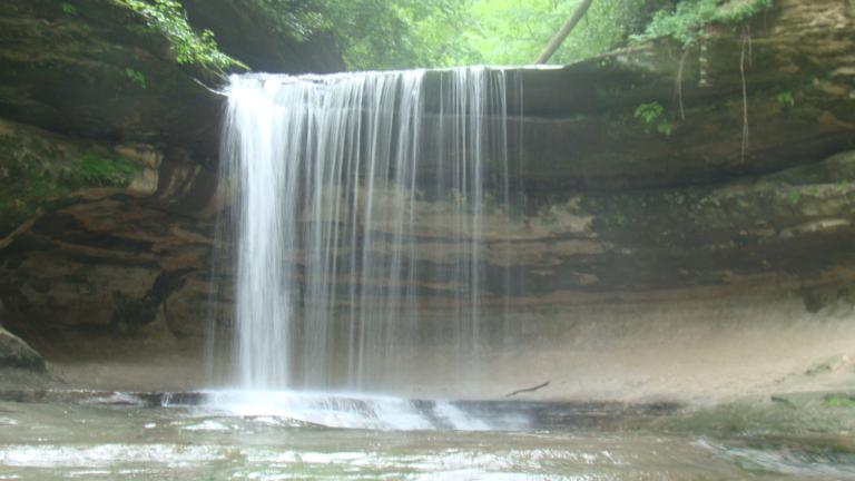 A waterfall flows at Staved Rock State Park